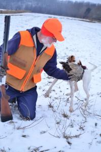 Treff Earney takes a bird from Leah.
